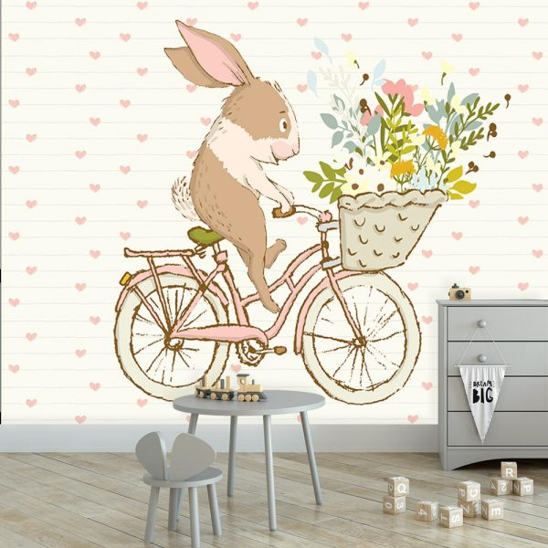 królik na rowerze