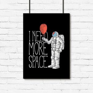plakat z astronautom i napisem